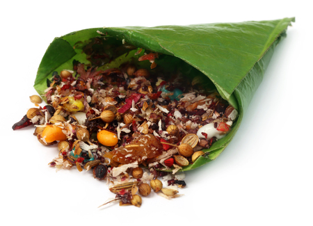 hydroxide: Decorated edible betel leaf for festivals over white background Stock Photo