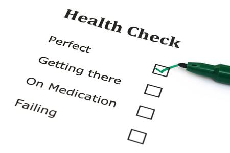 Health checklist with green marker pen photo
