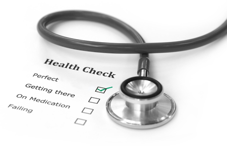 Health checklist and a stethoscope on a paper Stock Photo