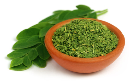 Green and dired moringa leaves with a small bowl