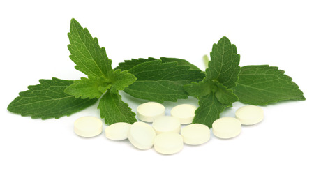 Stevia with tablets over white background Stock Photo