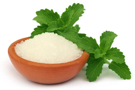 steviol: Stevia with sugar on a brown bowl over white background