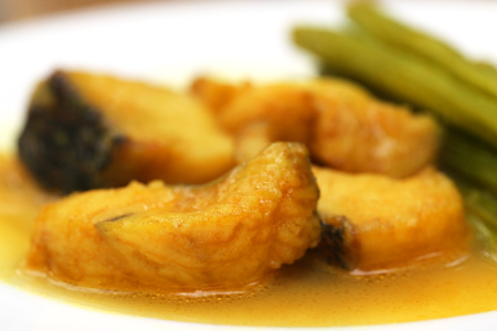 sajna: Moringa curry with fish on a plate