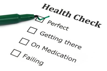 Health checklist with a green pen photo