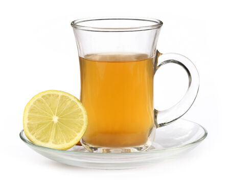 Cup of herbal tea with lemon over white background photo