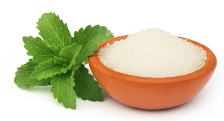 medicinal leaf: Stevia with sugar on a brown bowl