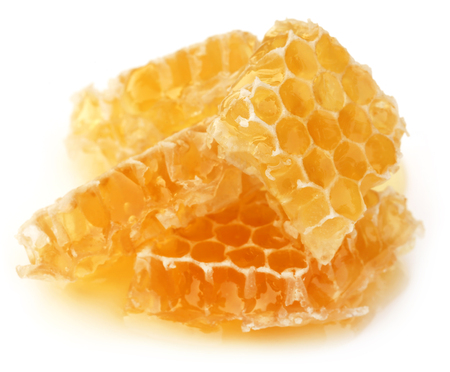 honey cell: Honey comb with fresh honey over white background
