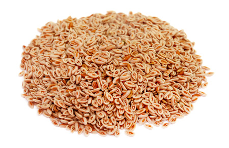 Medicinal Isabgol or psyllium husks over white background Stock Photo