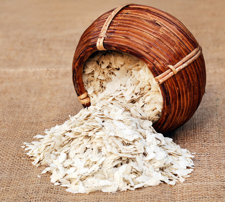flattened: Flattened rice of South East Asia from a basket