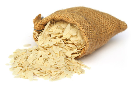 flattened: Flattened rice of South East Asia from a jute sack