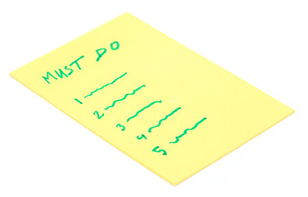 Must Do list in yellow paper