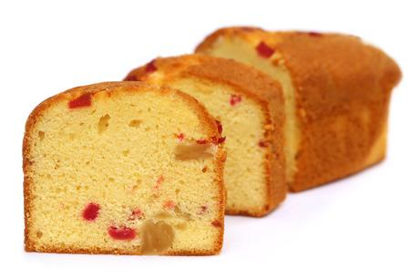 Sliced Fruitcake over white background photo