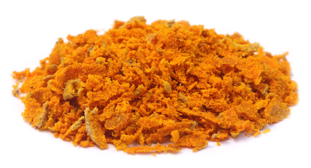 curcumin: Grated turmeric over white background