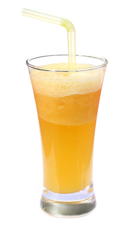 Pineapple juice in a glass over white background photo