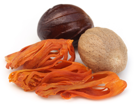 mace: Mace or Javitri Spice with nutmeg over white background