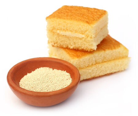 leavening: Yeast with bread over white background