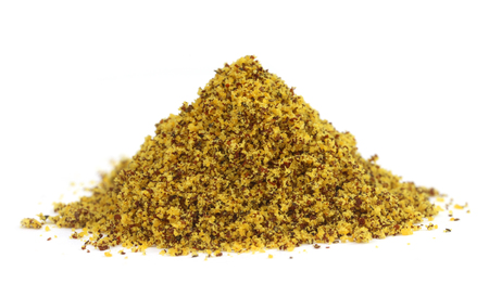 Pile of ground mustard over white background photo