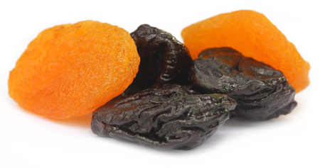 prune: Dried apricot with prune over white background