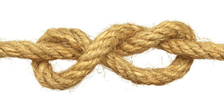 Knot on rope over white background photo