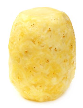 Peeled Pineapple over white background photo