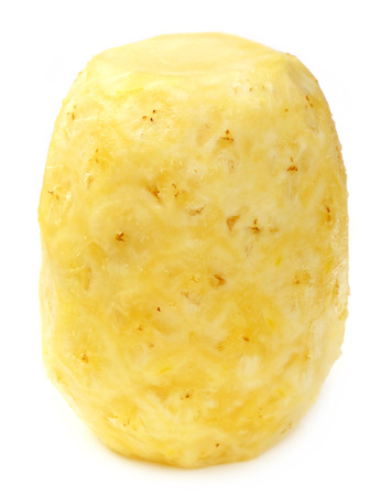 Peeled Pineapple over white background