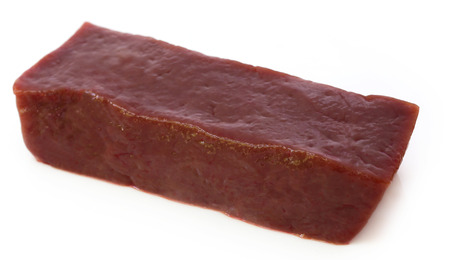Beef liver over white background photo