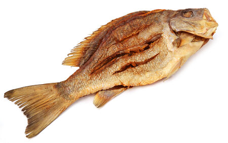 calcarifer: Dried Barramundi or Koral fish of Southeast Asia over white background
