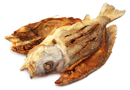 lates: Dried Barramundi or Koral fish of Southeast Asia over white background