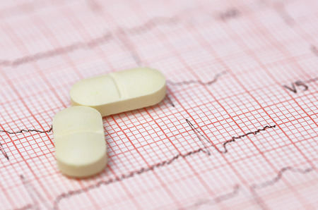 electrocardiograph: Close up of electrocardiograph with pills