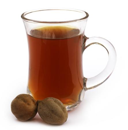 myrobalan: Indian Harbal Tea of Terminalia bellericais or medicinal Bahera fruits Stock Photo