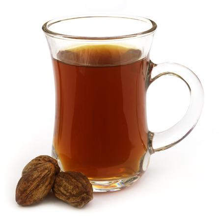 myrobalan: Ayrvedic Tea of Medicinal Haritaki fruits over white background