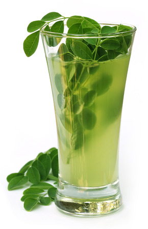 marango: Ayurvedic Juice made from moringa leaves over white background