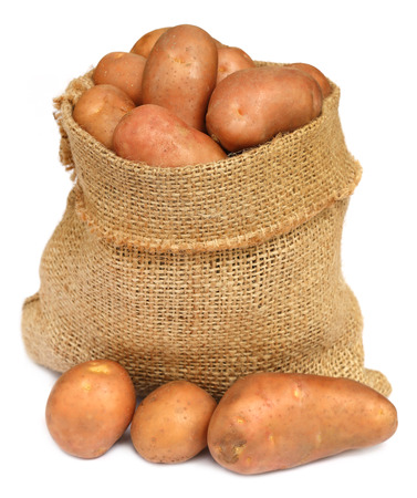 russet: Potatoes in a sack bag over white background Stock Photo