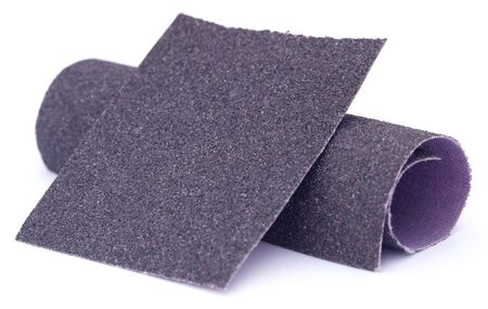 emery paper: Sand paper roll and sheet over white background
