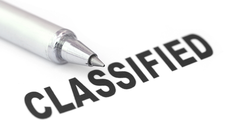 printed: Classified printed in a white paper with pen