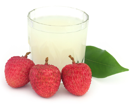 lychee juice: Lychee juice with fruits over white background