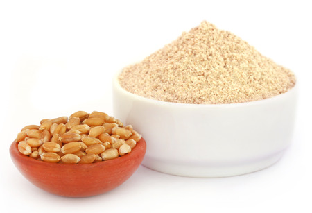 wheat grain: Fresh brown flour with wheat over white background