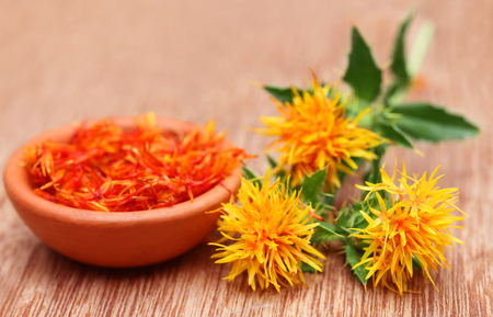 Safflower is a food additive on wooden surface