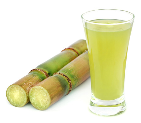 canes: Piece of sugarcane juice over white background