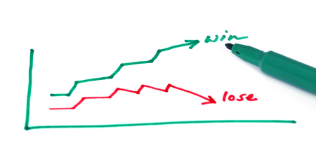 green line: Win Lose curve on a paper with pen Stock Photo