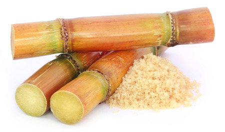 sugar powder: Piece of sugarcane with sugar over white background