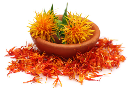 safflower: Safflower in a bowl over white background