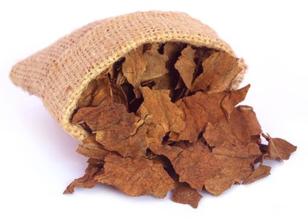Dried tobacco leaves from a sack