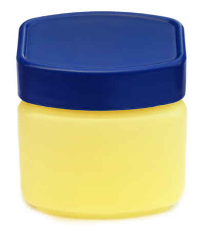 oily: Jar for petroleum jelly over white background