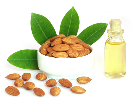 almond: Fresh almonds with oil over white background Stock Photo