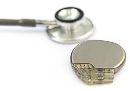 pacemaker: Pacemaker with stethoscope over white background
