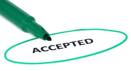 accepted: ACCEPTED written in a white paper and a green sign pen