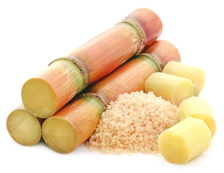 sugar powder: Piece of sugarcane with red sugar over white background