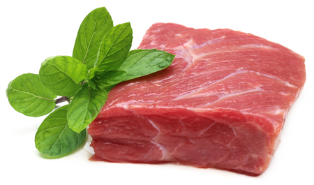 mint leaves: Raw beef with mint leaves over white background