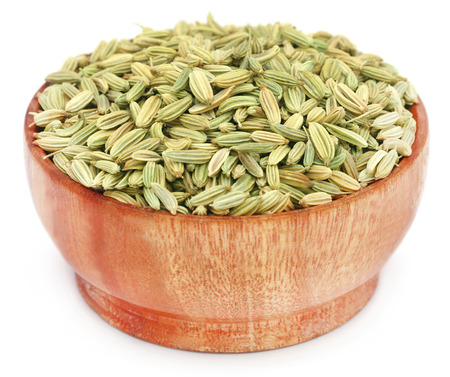 fennel seeds: Fennel seeds in wooden pot over white background
